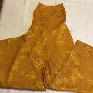 Urban Outfitters gold jumpsuit.  Size 4